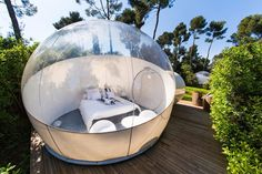 "Attrap'Rêves  Chemin de la Ribassière  13190 Allauch cological, tasteful, and a little funky, these ""tent bubbles"" give you a view of the outdoors, with the luxury of an aesthetically modern living space. With only a thin layer of privacy between each accommodation and nature, these bubbles fall into the category of contemporary ""glamping""."