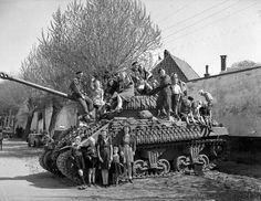 17-pounder Sherman Firefly of Lord Strathcona's Horse in the Netherlands, April 1945, showing the extent to which extra tracks were often applied to tanks in Canadian service. LAC Photo.
