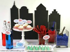 For any Superman {or Super Hero} themed party you can enhance the decor with this easy DIY cityscape backdrop, as seen in my 5 ideas for a fun Superman party. The tutorial is rather simple but you do need a steady hand to cut out the shapes. Once you make the backdrop you can prop it up behind a
