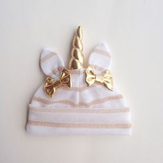 White & gold unicorn hat by lovewhatsmissing on Etsy https://www.etsy.com/listing/490403060/white-gold-unicorn-hat