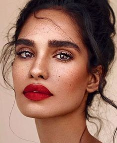 red lips and strong brows, a bold make-up look that is always impressive for any occasion