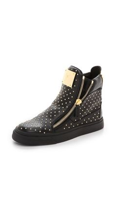 6740b96a8aec7 Edgy, studded-leather Giuseppe Zanotti sneakers with signature double-zip  styling. A