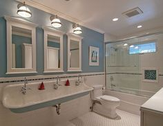 Kids Bathroom Idea--this would eliminate some fighting. Huge sink with three faucets and three mirrors!