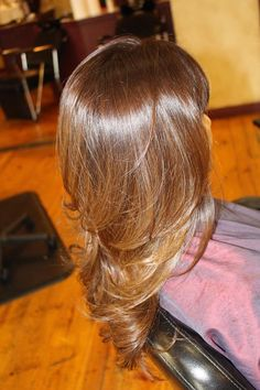 Subtle ombré on light brown hair with layered cut