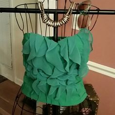 BODY CENTRAL STRAPLESS RUFFLED BLOUSE Ready for St Patrick?s Day in this cute body central ruffled top. Ruched sides and exposed back zipper. Add your cut offs and let the fun begin! Body Central Tops Blouses