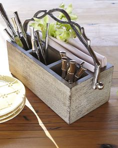 Weathered-Wood Flatware Caddy Functional as well as decorative, this flatware caddy juxtaposes a weathered-wood body with branch-motif metal handles for a look that is both rustic and sophisticated.