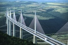 The Millau Viaduct is a cable-stayed road-bridge that spans the valley of the river Tarn near Millau in southern France. Designed by the French structural engineer Michel Virlogeux and British architect Norman Foster, it is the tallest bridge in the world with one mast's summit at 343.0 meters above the base of the structure. The 2460 meters long bridge is the 12th highest bridge in the world, with a 270 meters drop from the bridge road to the valley below.