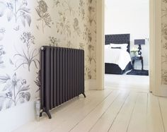 Tetro: combines all the benefits of aluminium radiators with beautiful traditional styling. Made of recycled material, this innovative model is high tech but with classic appeal. Height 639 Sections 24 Length 220 Watts 1847 BTUs 6301 £1097 white £1371 volcanic