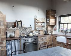 Piet Hein Eek // farmahouse in West Sussex // The kitchen cabinetry is made entirely from reclaimed wood.
