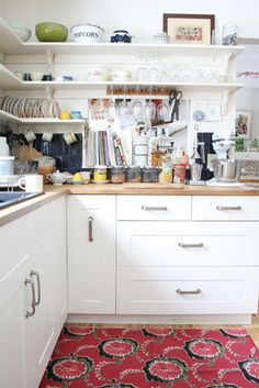 white shelves up to put dishes up on.  i have all different styles and colors of green dishes that would look pretty out.