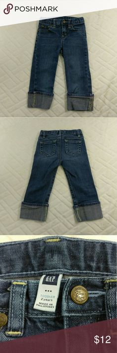 """GAP Boyfriend Cut Jeans Girls Size 2T EUC Excellent used condition, no noted flaws. Shows minor wear from normal use. Light to moderate washed look. Girl's size 2T. 99% Cotton, 1% Spandex. Adjustable waistband. Snap-on front fly button. Pink stitching and floral accents on bottom leg fold. Machine wash. Aprox. laying flat measurements: 10"""" waist (adjustable), 11.5"""" inseam, 7"""" frontrise, 10"""" backrise, 18.5"""" long.  Remember to bundle up and save, so check my closet for more treasure finds. GAP…"""