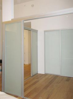 The Sliding Door Company silver finish room divider, solo design and frosted glass #the_sliding_door_company