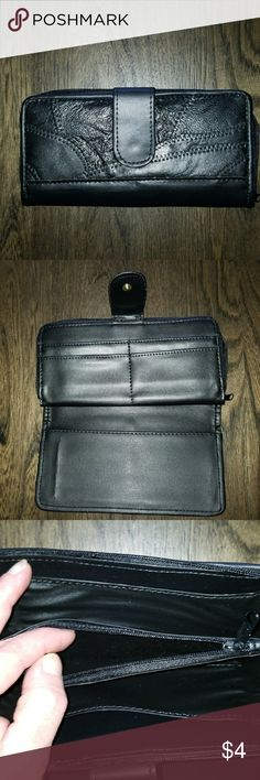 New faux leather wallet NWOT.  Black faux patchwork leather.  Has bill and change area in the back and in front a checkbook cover and 4 card slots. Measures 4 x 8 Bags Wallets
