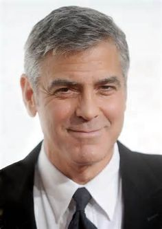 George Clooney has seen the light and  has dumped that tall, leggy, beautiful blonde thus giving himself one more chance to win my heart. Don't blow it this time, George!