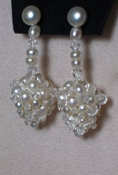 """One-of-a-kind stunning earrings with detachable drops....the perfect gift for a wedding or other special events. Handmade by designer Sylvia Bntcheva.  Freshwater pearls, Swarovski crystals and 14K gold post.  Comes in 2"""" and 3"""" drops. Please contact for details Sylvia at:www.alterations avenue.com or www.sbcouture.com"""