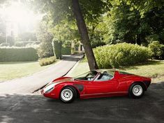 """ALFA ROMEO TIPO 33 STRADALE (1968)-The Alfa Romeo 33 Stradale is an extremely rare road car built by Alfa Romeo of Italy. Only 18 are reported to have been made, plus three design studies based on the 33 Stradale the 33.2, Iguana and Carabo. """"Stradale"""" is Italian for Road or Traffic.In Top Gear's 100 Sexiest Cars list, the Alfa Romeo 33 Stradale was featured as number 15."""