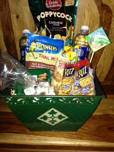 Great idea for a welcome basket.  Snacks and water and a little stick with a printed unit or military post/base cardstock piece glued to top.  Slap on a unit crest or logo sticker in the color of your unit, and you're done!  Can also include local maps and brochures and such.
