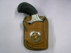 Leather cowboy holster for a NAA Pug.