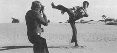 Actor James Coburn getting some shots of Bruce Lee during a location scout for a film that never materialized.