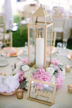 Elegant pink, white, and gold centerpieces / http://www.himisspuff.com/100-unique-and-romantic-lantern-wedding-ideas/2/
