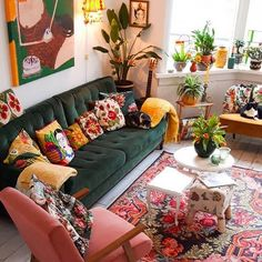Maximalist throw pillows, rug and house plants.