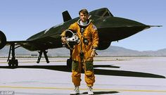 Reconnaissance Systems Officer George Morgan stands in front of a Cold War-era U.S. Air Force SR-71 spy plane in an undated photo