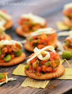 Can you imagine biscuits that taste as exciting as any of our desi delicacies like cutlets or pav bhaji? Well, here is a creation that will just about fulfill that dream! Salted biscuits with a topping of tomatoes, onions and mixed vegetables sautéed in butter and perked up with tomato ketchup and coriander, is sure to be quite interesting to the palate. One thing to keep in mind is that you can keep the topping ready, but should assemble the Mixed Vegetable Topping on Salted Biscuits just…