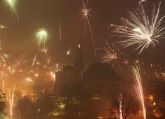 Fireworks light the sky above the medieval Mariendom (Cathedral of Mary), left, and the St. Severi's Church, right, shortly after midnight during New Year's Eve celebrations in Erfurt, Germany, on January 1, 2015. (AP Photo/Jens Meyer)