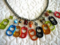 Necklace made from drink pop tabs, an aluminum chain, some wire wrapped links, and beads. Soda Tab Crafts, Can Tab Crafts, Aluminum Can Crafts, Bottle Cap Crafts, Tape Crafts, Aluminum Cans, Bottle Caps, Cute Jewelry, Jewelry Crafts