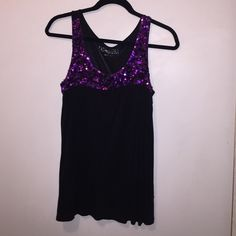 Black top with purple sequins Cute black w/purple sequins top.  Easy loose styling.  Dress it up or wear it with jeans!  100% Modal.  Follow washing instructions on the tag. Tops