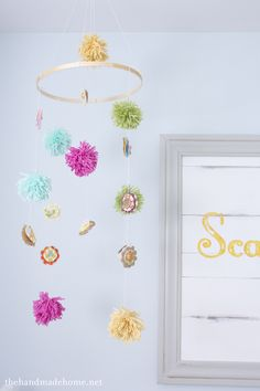 Pom and flower mobile. (Not just for nurseries!) Pretty kidlet/playroom room decor.