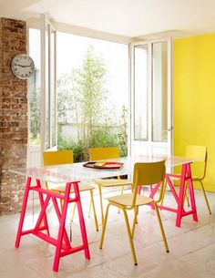 great cheap way to put together a modern looking dining table. DIY idea: colour sawhorses & sheet of glass for dining table