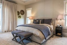Master Bedroom. The interior designer went for an elegant but relaxed vibe in this master bedroom with linen bedding from Restoration Hardware and custom linen drapery. Upholstered x-benches are by Lee Industries. #masterbedroom #bedroom master-bedroom Restyle Design, LLC.