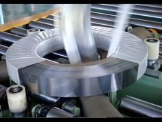 Coil packing line by film and paper