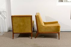 Pair of Mid-Century Lounge Chairs   From a unique collection of antique and modern chairs at https://www.1stdibs.com/furniture/seating/chairs/
