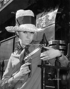 Mean looking gun slinging type in the tall crowned straw stetson is Danish Model Karin Jensen April 1964, General, Stetson Hat1964 (c) TopFoto / Alinari Archives