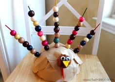Make this easy fine motor turkey activity with dowel rods, beads, and a styrofoam ball.  Perfect for your toddlers or preschoolers before Thanksgiving!