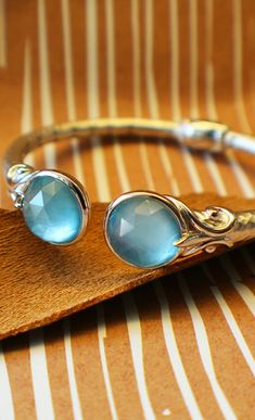 Like Aegan blue eyes looking out from a distant time, this bracelet stands out among hammered jewelry. This cuff is a fusion of silver and stainless steel with a nice little iridescent shimmer.
