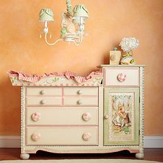 forget the color scheme and the chandelier. I like the idea of combining the diaper changing table and the dresser and making it space accessible
