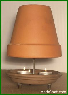 ▷ 1001 + Ideen und Bilder zum Thema Teelichtofen selber bauen a white wall and a diy tealight oven m Terra Cotta Heater, Do It Yourself Camping, Candle Heater, Diy Heater, Homemade Heater, Brown Plates, Ceramic Flower Pots, Ceramic Pots, Clay Pot Crafts