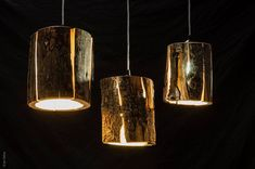 15 Wood Pendant Lights That Add A Natural Touch To Your Decor // These cracked log pendant lamps make use of the naturally occurring cracks and give the lights a more rustic feel.