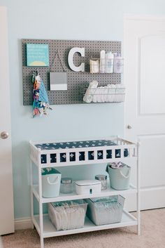 Modern Blue and Gray Nursery Pegboard above Changing Table for Storage - looks great and is functional! Love this nursery organization idea!Pegboard above Changing Table for Storage - looks great and is functional! Love this nursery organization idea!