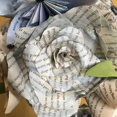Handmade rose made out of recycled book pages.
