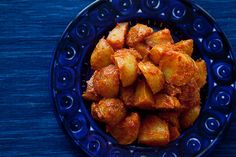 """PATATAS BRAVAS"" SPANISH ROASTED POTATOES WITH TOMATO SAUCE: A classic Spanish tapas appetizer known as patatas bravas, or angry potatoes - roasted potatoes tossed with a spicy, smoky tomato sauce."