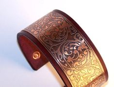 LOVE. have different color leather too.  Etsy listing at https://www.etsy.com/listing/165340835/leather-and-etched-copper-women-cuff
