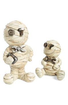 Add a retro twist to your Halloween decor with these fabulous Steampunk Mummy figurines.