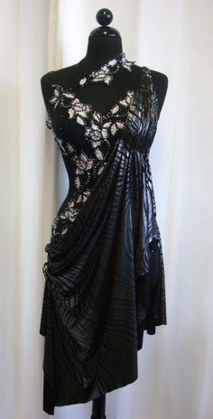 Black and lacy latin dress with rhinestone flowers. Visit http://ballroomguide.com/comp/attire/lady.html for more info about competition attire.