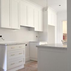 Kitchen renovation at the Bondi project. Cabinetry colour: Dulux 'Vivid White', Hardware: Schoolhouse Electric   Photo and design by @cottonwoodinteriors