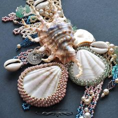 Beads with shells. Would love to see the whole of this necklace!  Curleytop1.