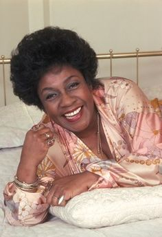 "Isabel Sanford (August 29, 1917 – July 9, 2004) was an American stage, film and television actress best known for her role as Louise ""Weezy"" Jefferson on the CBS sitcoms All in the Family (1971–1975) and The Jeffersons (1975–1985). She was the first African American actress to win a Primetime Emmy Award for Outstanding Lead Actress in a Comedy Series."